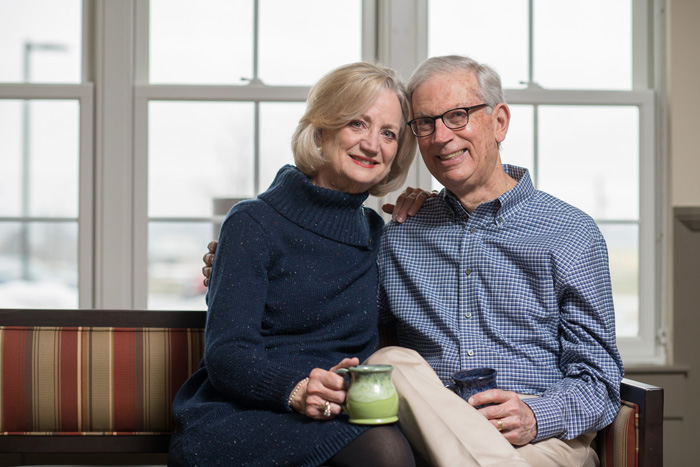 Photo of couple holding coffee mugs