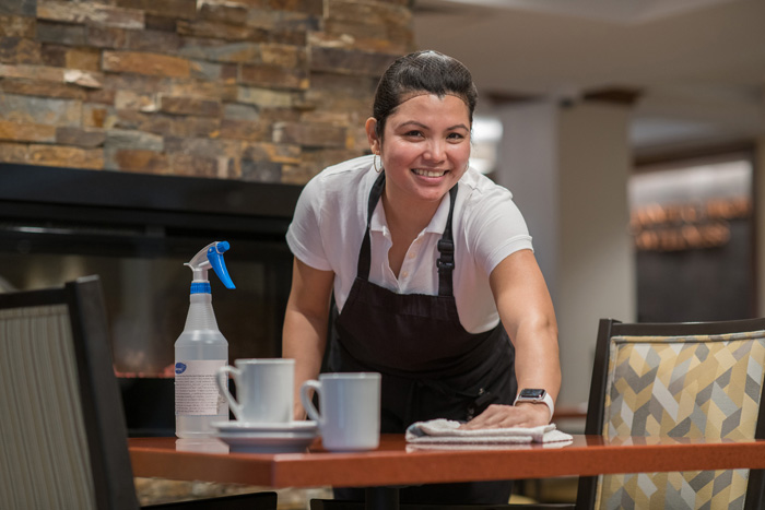 Woman cleaning dinner table