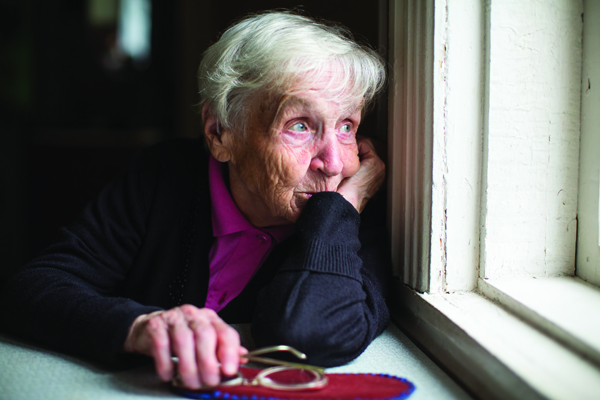 Senior looking out of window