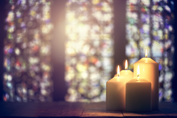 Candles and stained glass windows