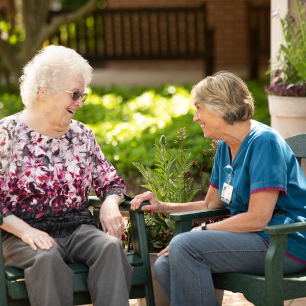 Resident talking with health care worker