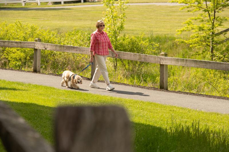 Female resident walking her dog
